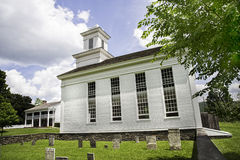 Cornwallville Church. Built in 1795, in the historic village at Farmers' Museum, Cooperstown, New York.  In the background is Bump Tavern, built in 1797 Stock Photography