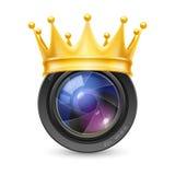 Coroa dourada na lente Fotos de Stock Royalty Free