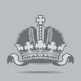 Coroa imperial com joias em um fundo cinzento Fotografia de Stock