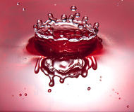 Coroa líquida vermelha Imagens de Stock Royalty Free