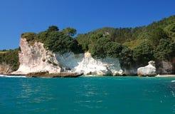 Coromandel Peninsula. White rock hits the crystal clear Pacific Ocean on the Coromandel Peninsula, New Zealand Royalty Free Stock Photography