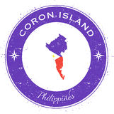 Coron Island circular patriotic badge. Grunge rubber stamp with island flag, map and name written along circle border, vector illustration Stock Images