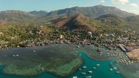 Coron town aerial view. Philippines, Palawan, Busuanga. Sea port, pier, cityscape Coron town with boats on Busuanga island, Philippines, Palawan. Coron city with royalty free stock images