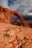 Corona Arch. Against Stormy Sky with Cactus Plant in Foreground Royalty Free Stock Photo
