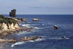Corona Cliffs. Scenic cliffs rise above the surf in Corona del Mar, California stock photos
