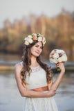 Corona del fiore e della ragazza Fotografia Stock
