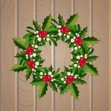 Corona del vischio di Natale su fondo di legno Immagine Stock