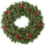Corona di Natale con le bacche e le bagattelle rosse Fotografie Stock