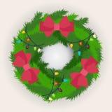 Corona di Natale decorata con gli archi rossi Immagini Stock Libere da Diritti