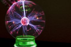 Corona discharge in a gaseous medium with the example of fingers and coil Tesla. Plasma ball. stock photography