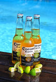 Corona Extra Beer. Belgrade, Serbia - August 6, 2015: Corona Extra shot on swiming pool with pieces of limes. Corona is an Imported Beer from Mexico royalty free stock photos