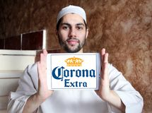 Corona extra beer logo. Logo of Corona extra beer on samsung tablet holded by arab muslim man. Corona Extra is a pale lager produced by Cervecería Modelo in stock images