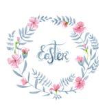 Corona floreale dell'acquerello con i fiori rosa, le foglie, i brunch e le lettere disegnate a mano (parola Pasqua) Immagini Stock Libere da Diritti