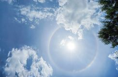 Corona of the Sun in bright blue sky with clouds. Corona of the Sun in bright blue sky with white clouds stock photos