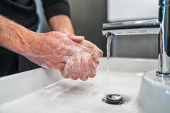 Free Corona Virus Travel Prevention Man Showing Hand Hygiene Washing Hands With Soap In Hot Water For Coronavirus Germs Royalty Free Stock Photos - 175357918