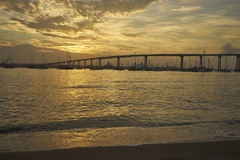 Coronado Bay, San Diego, California welcomes another beautiful day as the sun bathes everything in a warm golden light. View from Dinghy Landing on Coronado stock image