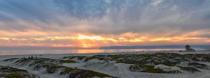 Coronado Beach in San Diego by the Historic Hotel del Coronado, at sunset with unique beach sand dunes, panorama view of the Pacif. Ic Ocean, silhouettes of royalty free stock photography