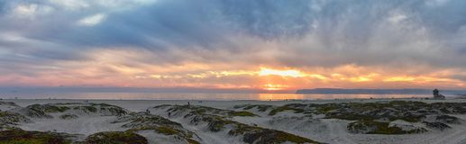 Coronado Beach in San Diego by the Historic Hotel del Coronado, at sunset with unique beach sand dunes, panorama view of the Pacif. Ic Ocean, silhouettes of royalty free stock photo
