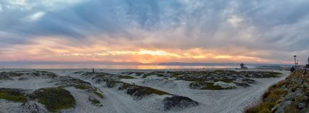 Coronado Beach in San Diego by the Historic Hotel del Coronado, at sunset with unique beach sand dunes, panorama view of the Pacif. Ic Ocean, silhouettes of stock photos