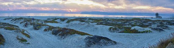 Coronado Beach in San Diego by the Historic Hotel del Coronado, at sunset with unique beach sand dunes, panorama view of the Pacif. Ic Ocean, silhouettes of royalty free stock images