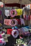 coronas coloridas hechas de flores falsas Fotografía de archivo libre de regalías