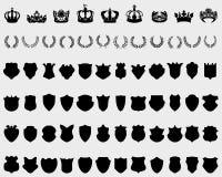 Coronas, escudos y guirnaldas del laurel Imagen de archivo libre de regalías
