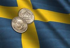 Coronas suecas en la bandera Imágenes de archivo libres de regalías