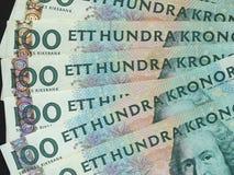 100 coronas suecas y x28; SEK& x29; notas, moneda de Suecia y x28; SE& x29; Fotos de archivo libres de regalías