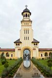 Coronation Cathedral in Alba Iulia. Bell Tower and entrance in courtyard of Coronation Cathedral in Alba Iulia known as Reunification Cathedral Stock Photo