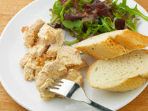 Coronation Chicken with salad and bread Stock Photos