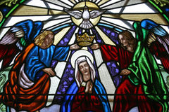 Coronation of Mary. Stained glass church window Stock Photo
