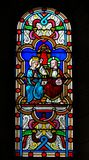 Coronation of Mother Mary by Jesus Christ in Heaven. Stained Glass in the Cathedral of Monaco depicting the Coronation of Mother Mary by Jesus Christ in Heaven royalty free stock image