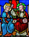 Coronation of Mother Mary by Jesus Christ in Heaven. Stained Glass in the Cathedral of Monaco depicting the Coronation of Mother Mary by Jesus Christ in Heaven stock photo