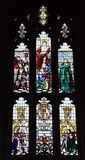 Coronation stained glass Window. Winchester, United Kingdom - April 29 2018: A stained glass window in Winchester Cathedral commemorating the cornations of stock image