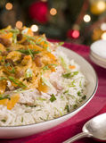 Coronation Turkey Rice Salad. On a plate with spoon Royalty Free Stock Image