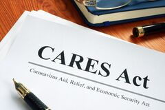 Free Coronavirus Aid, Relief, And Economic Security CARES Act On The Desk Stock Image - 178177201