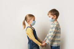 Coronavirus Concept With Two Kids, Pretty Girl And Boy In Medical Mask Royalty Free Stock Photos