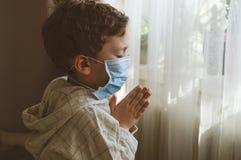 Free Coronavirus Covid-19. Child Praying To God Requesting That The Coronavirus Covid 19 Not Spread Beyond Control. Stock Photos - 176926463