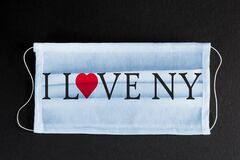 Coronavirus Covid-19 in New York. Words I LOVE NY printed on medical mask. City healthcare concept.