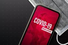 Coronavirus or Covid-19 outbreak News Update background concept. Mockup mobile phone Coronavirus News with facial masks. Flat lay