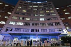 Coronavirus Crisis in Spain: Medical staff applaud at the entrance of the Fundacion Jimenez Diaz hospital in Madrid