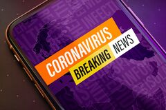 Free Coronavirus Or Covid-19 Pandemic  Breaking News Update Background Concept. Close Up Mobile Phone With Coronavirus Breaking News Royalty Free Stock Photos - 182748298