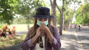 Coronavirus. Asian woman putting on a medical disposable mask to avoid viruses.