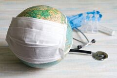 Coronavirus plague on earth globe with mask abstract concept