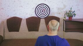 Coronavirus quarantined couples play darts in their free time at home.
