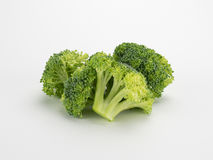 Corone dei broccoli su bianco Fotografia Stock Libera da Diritti