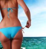 Corpo fêmea no swimwear e no mar Fotografia de Stock