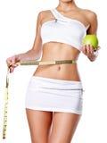 Corpo fêmea saudável com maçã e a fita de medição. fotografia de stock