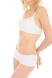 Corpo magro da mulher do ajuste bonito no roupa interior branco imagens de stock