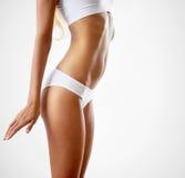 Corpo magro da mulher tanned foto de stock